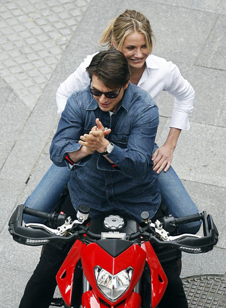 U.S. actors Tom Cruise and Cameron Diaz sit on a bike on the set during the filming of