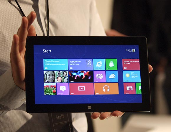 A Microsoft representative holds a new Surface tablet computer as it is unveiled by Microsoft in Los Angeles, California, June 18, 2012.