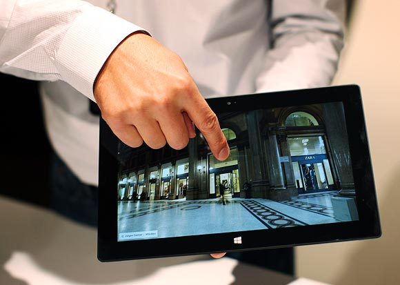 A Microsoft representative scrolls the screen of the new Surface tablet computer as it is unveiled in Los Angeles, California, June 18, 2012.