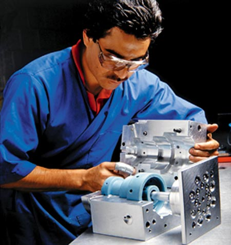 A professional works on the design of a plastic mould