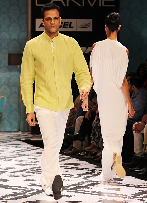Model Jitin Gulati presents an Anita Dongre's creation