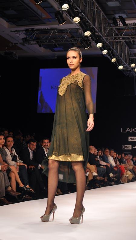 A model walks the ramp in Kavita Bhartia's golden-black cocktail dress.