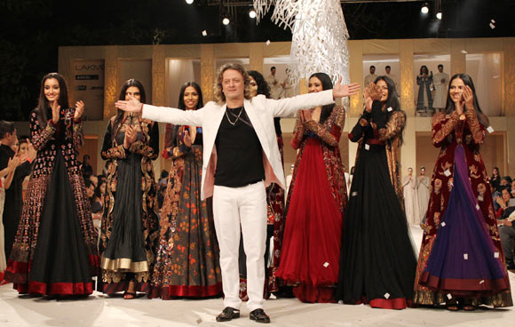 Rohit Bal takes to the ramp as his muses cheer for him