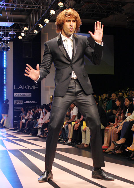 A model entertains onlookers in a Narendra Kumar outfit