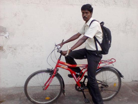 G Murgaraj delivers books on his cycle