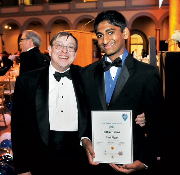 Nikhil Tumma (right) with Intel Science Talent Search judge Andy Yeager