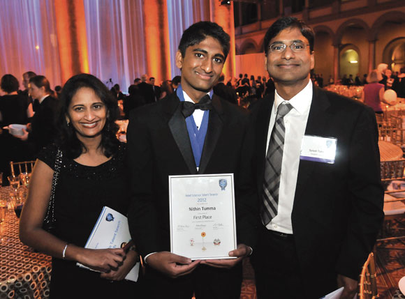 Nithin Tumma (centre) with his parents Dr Kavita (left) and Dr Suresh (right)