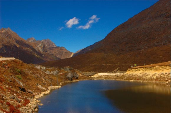 Arunachal Pradesh shares its borders with three countries -- Bhutan in the west, Burma in the east and China in the north. Literally translated as 'land of the dawn-lit mountains' Arunachal Pradesh is one of the most beautiful as well as a sensitive state given its proximity to China.