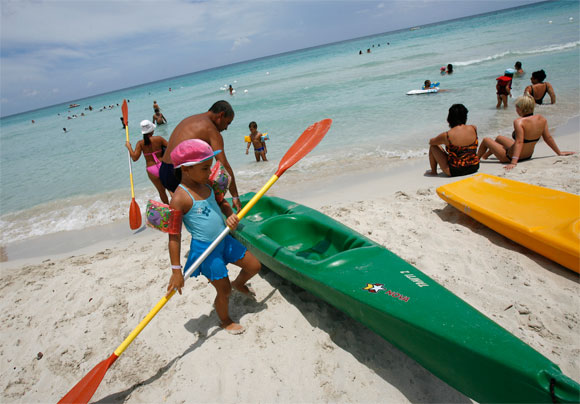 Vacationing Cubans get ready to board a kayak near a beachfront hotel in Varadero, 145 km east of Havana.
