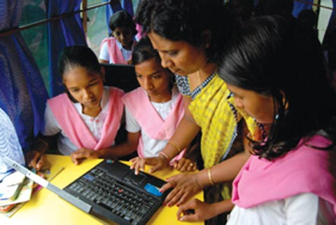 Students attend a computer education class in the mobile B-school