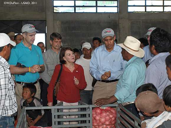 Dr Rajiv Shah talks with farmers about processing produce in new packing shed in Sacapulas, Quiche, Guatemala