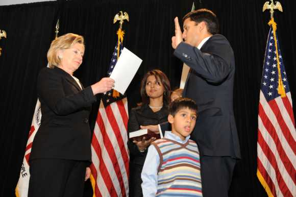 Secretary of State Hillary Rodham Clinton administers the oath of office to USAID Administrator Rajiv Shah in Washington, D.C., Jan. 7, 2010, as his family looks on.