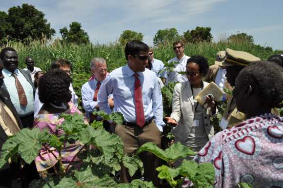 USAID Administrator Rajiv Shah listens as USAID/Sudan Economic Growth Deputy Team Leader Carmelita Maness describes local agriculture in southern Sudan