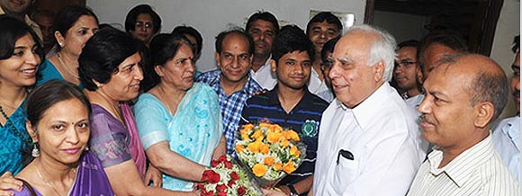 Arpit Aggarwal being congratulated by HRD minister Kapil Sibal