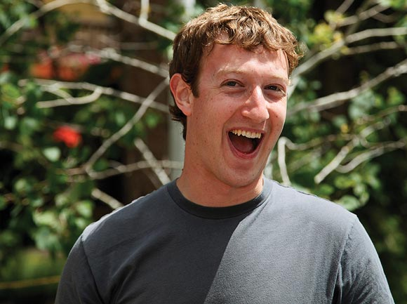 Mark Zuckerberg, Facebook CEO and founder laughs outside the Sun Valley Inn in Sun Valley, Idaho July 9, 2009. The resort is the site for the annual Allen & Co's media and technology conference.
