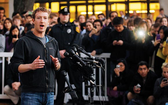 Facebook founder and CEO Mark Zuckerberg speaks to reporters at Harvar