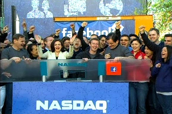 Facebook Founder and CEO Mark Zuckerberg, shown in this image from Reuters video, rings the NASDAQ Stock Market Opening Bell remotely from