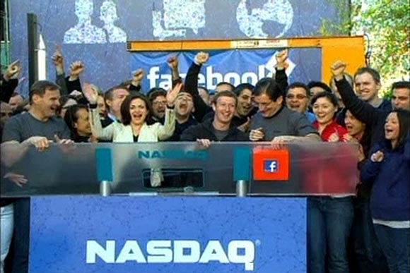 Sheryl Sandberg, third from left, with Facebook founder Mark Zuckerberg ring the NASDAQ stockmarket Opening Bell remotely from Facebook headquarters in Menlo Park, California, May 18