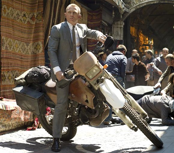 Daniel Craig as James Bond in Skyfall in an action scene atop Honda CRF250R