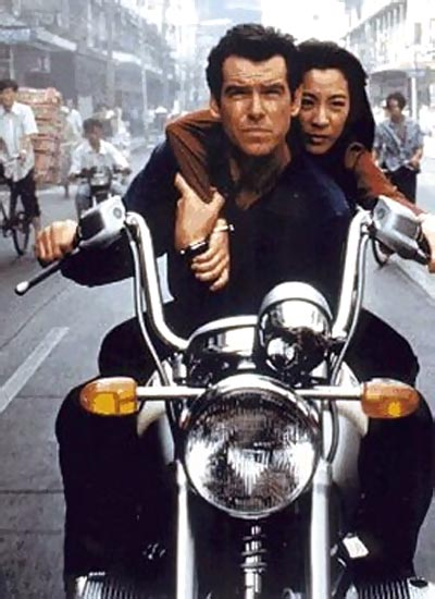 Pierce Brosnan as James Bond with Michelle Yeoh in an action sequence in Tomorrow Never Dies