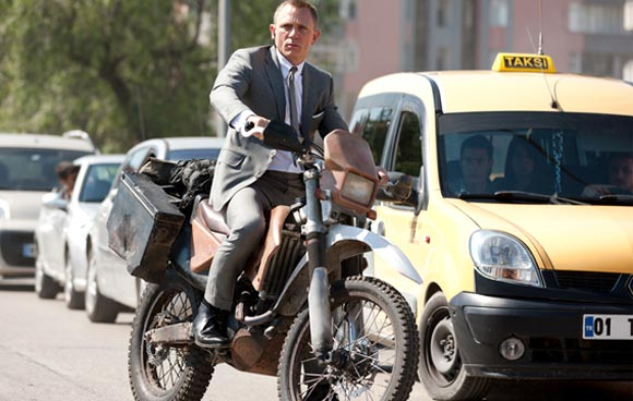 Daniel Craig as James Bond in an action sequence in Skyfall atop Honda CRF250R