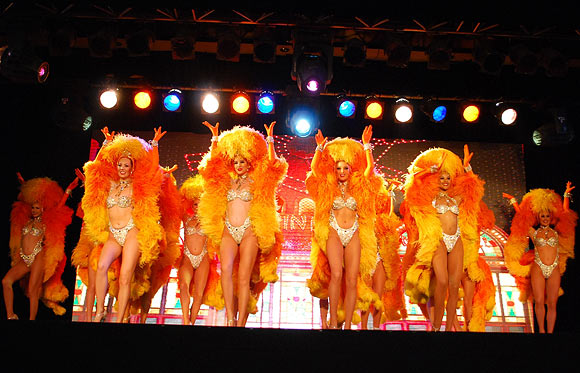 Moulin Rouge dancers perform at the Sofitel Mumbai BKC hotel in Mumbai on October 31, 2012
