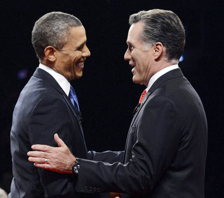 Republican presidential nominee Mitt Romney greets President Barack Obama at the start of the first 2012 US presidential debate in Denver