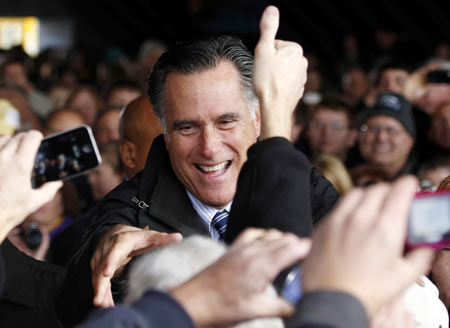 US Republican presidential nominee and former Massachusetts Governor Mitt Romney greets supporters at a campaign rally in Dubuque, Iowa, November 3, 2012.