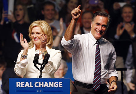 US Republican presidential nominee and former Massachusetts Governor Mitt Romney and his wife Ann at a campaign rally in Manchester, New Hampshire, November 5, 2012.