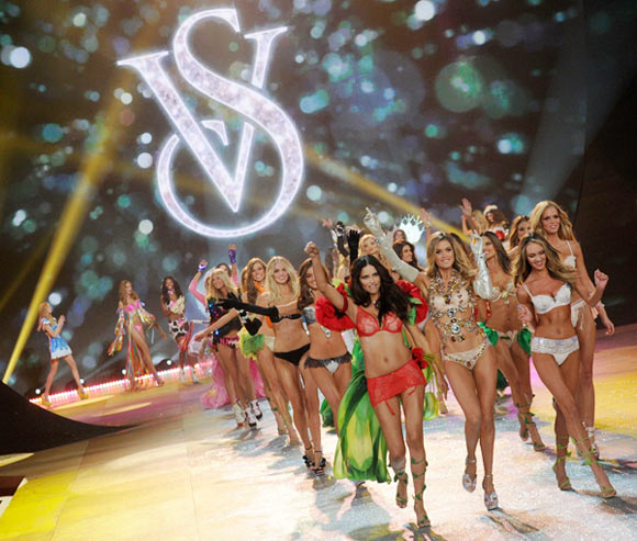 (Front row, left to right) Adriana Lima, Doutzen Kroes and Candice Swanepoel lead out the Angels at the close of the Victoria's Secret fashion show