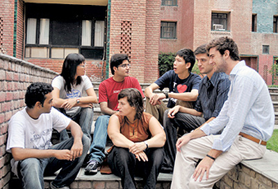 Students from IMT Ghaziabad catch up after finishing their classes.