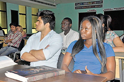 International students attend a lecture at the Manav Rachna International University, Fardabad