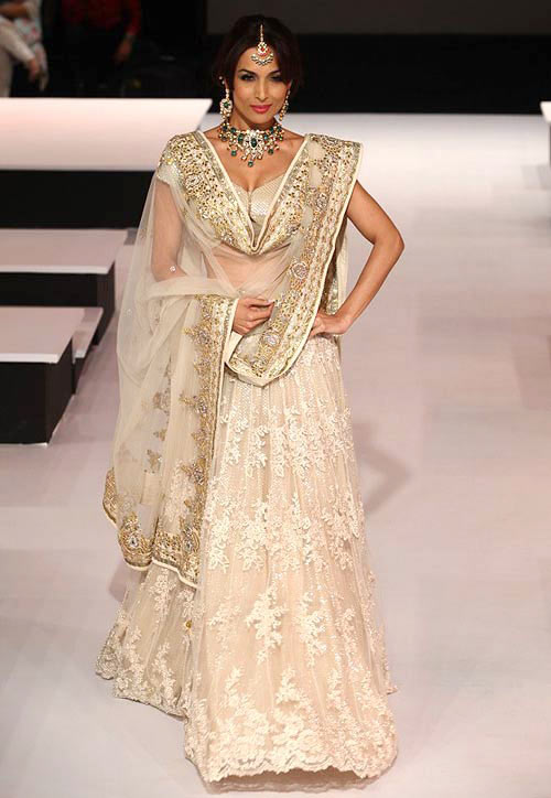 Malaika Arora accentuates her pear shape with an A-line lehenga and deep necked choli