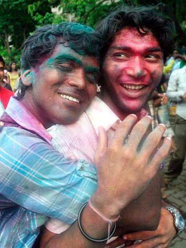 Men celebrate the court ruling over gay sex during a rally in Mumbai July 2, 2009