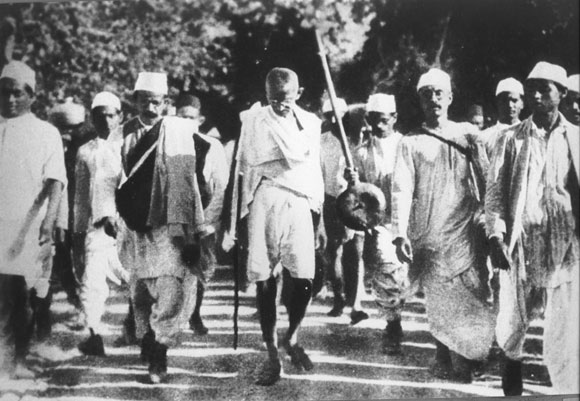 Gandhi walks to Dandi to protest against tax on salt, an act of defiance that shook the Empire