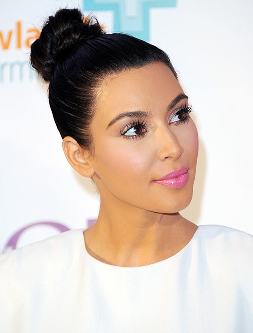 A tight ponytail or bun like Kim Kardashian's can harm your mane