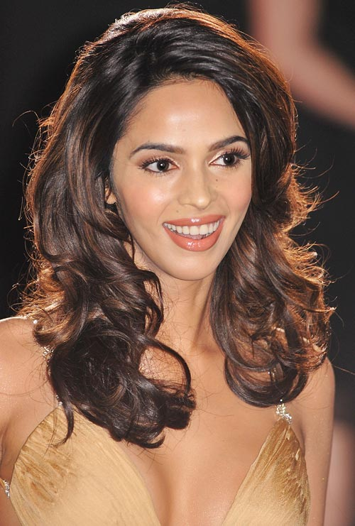 You may envy Mallika Sherawat's glossy mane, but over-brushing is not going to improve yours