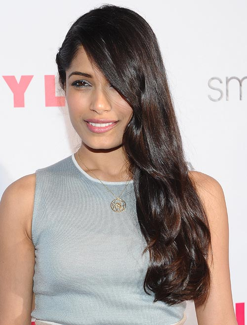 Shampoo only as often as you have to and keep your hair looking natural and healthy, like Freida Pinto