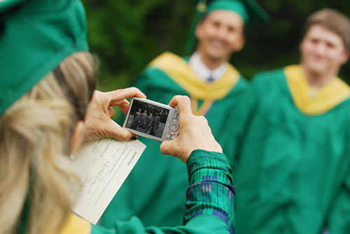 Students from George Mason University pose to get clicked on graduation day