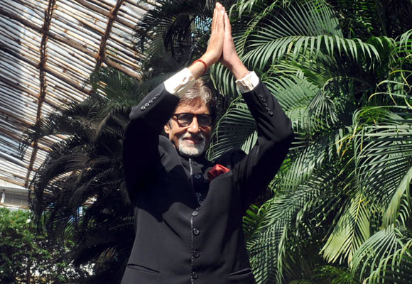 Amitabh Bachchan gestures to fans outside his residence in Mumbai on his 70th birthday