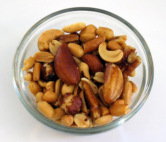 Most nuts including walnuts, almonds, peanuts, and pistachios have b