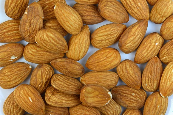 Nuts like almonds are high in polyunsaturated and monounsaturated fats, and contain naturally occurring cholesterol-lowering compounds called plant sterols