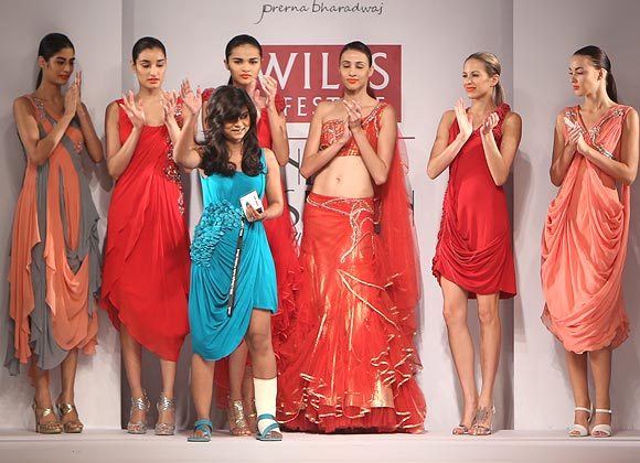 Prerna Bhardwaj's (centre) collection featured flowy gowns, drop shorts and multi-tiered net dresses