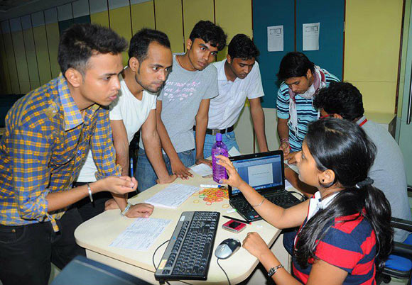 Students register for a summer induction programme.