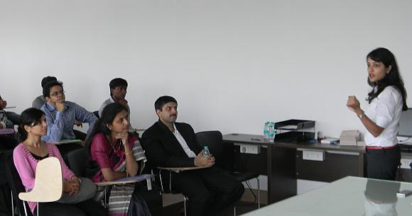 Sony Hooja (right) addressing students at a career counselling session