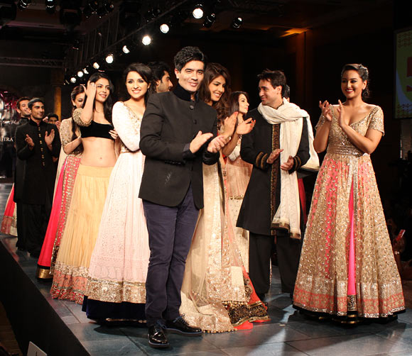 Manish Malhotra (front, left) escorts his celebrity muses onto the ramp