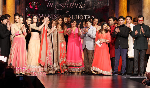 Shabana Azmi (sixth from left, front row) applauds Manish Malhotra (second from right), front row as the celebrities look on