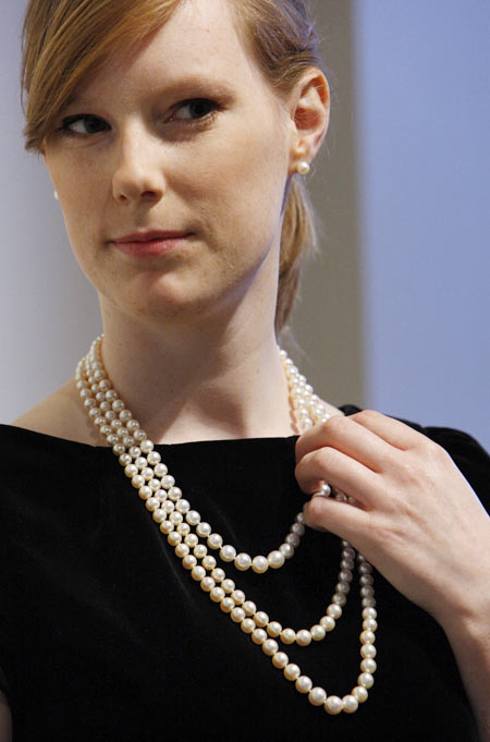 Joanna Bulmer, a Bonhams employee, models a pearl necklace at the auction house in London. The necklace once belonged to Catherine the Great and was expected to fetch $500,000 - $700,000 in an auction in New York in December 2008
