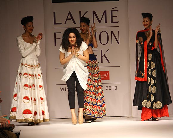 Designer Masaba Gupta taking a bow at the end of a fashion show