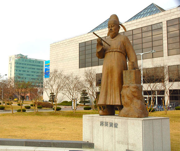 A statue of a Korea Scientist, Jang Young Sil in front of the science library